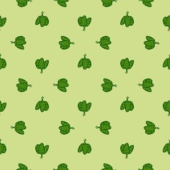 Jednolity wzór kilka sałatka ze szpinaku na jasnozielonym tłem. minimalistyczny ornament z sałatą.