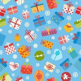 Jednolity wzór kolorowych pudełek na prezenty na jasnoniebieskim tle