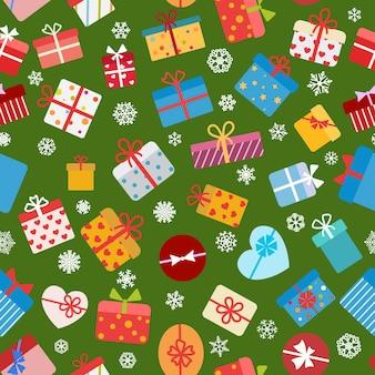 Jednolity wzór kolorowych pudełek prezentowych na zielonym tle