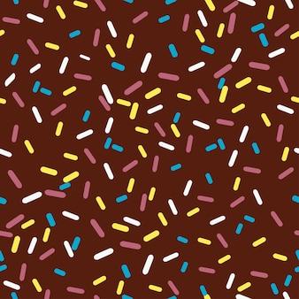 Jednolity wzór polewy czekoladowej do pączka. brązowe tło z ozdobnymi kolorowymi posypkami. ilustracja wektorowa.