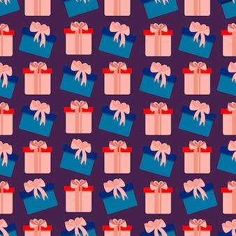 Jednolity wzór z miękkimi różowymi i niebieskimi pudełkami na prezenty śliczny świąteczny nadruk