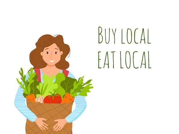 Jedz lokalne produkty ekologiczne kreskówka wektor koncepcja. kolorowa ilustracja szczęśliwy rolnik charakter dziewczyna trzyma wiadro z uprawianymi warzywami.