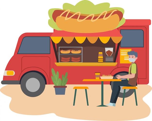 Jedzenie ciężarówki sprzedawania hotdog uzupełnia z niektóre krzesłem i stołem dla klient ilustraci
