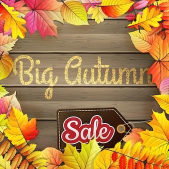 Jesień duża sprzedaż plakat typografia na tle drewna.