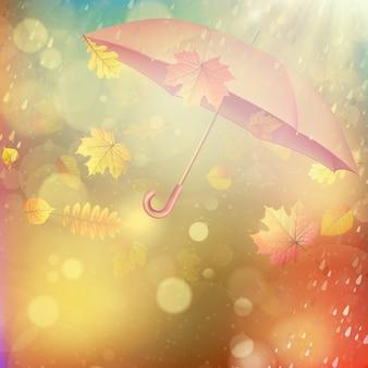 Jesień tło z liśćmi i parasolem.