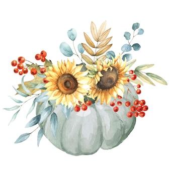 Jesienna kompozycja z dyni, słoneczników, liści eukaliptusa, jagód jarzębiny.