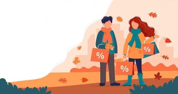 Jesienna wyprzedaż, mężczyzna i kobieta z torby na zakupy jesienią.