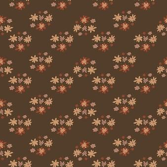 Jesienne odcienie szwu z kreskówkowym nadrukiem kwiatowym ornamentem. brązowe tło.