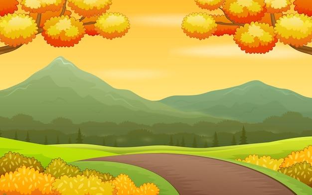 Jesienny krajobraz tło z drogą i górami
