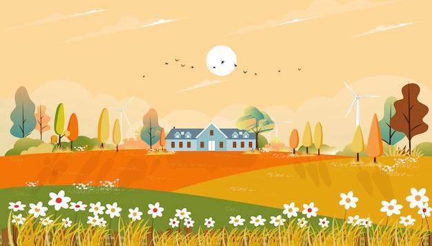 Jesienny krajobraz z domem i trawą na wzgórzach, naturalne liście w sezonie jesiennym z piękną panoramą w słoneczny dzień rano.
