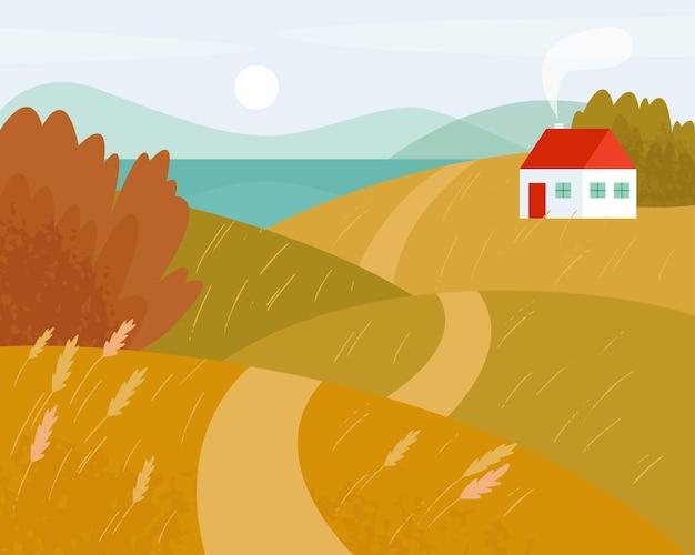 Jesienny krajobraz z drogą i białym domem jesienne pola droga biegnie przez wzgórza do jeziora