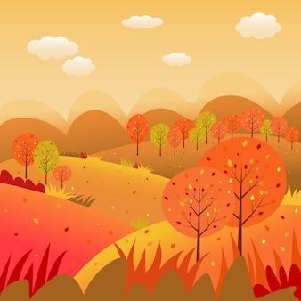 Jesienny krajobraz z polnymi górami, dziką trawą i liśćmi spadającymi z drzew