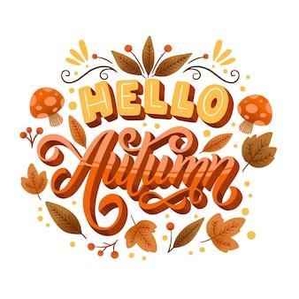 Jesienny napis z liśćmi i grzybami