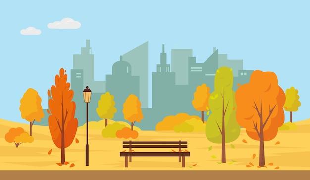 Jesienny park z drzewami i ławką w mieście.