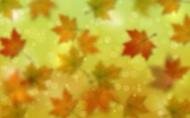 Jesienny styl niewyraźne tło z efektem bokeh i kolorowymi liśćmi