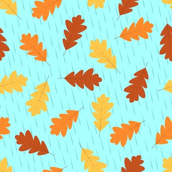Jesienny wzór, żółte i czerwone liście dębu opadają jesienią