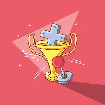 Joystick do sterowania grami wideo i puchar z trofeami