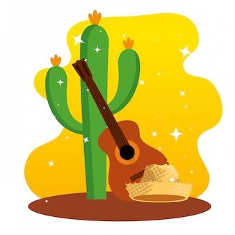 Kaktusowe rośliny z dekoracją gitary i kapelusza
