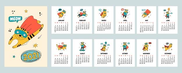 Kalendarz 2021 z ręcznie rysowanymi kotami i psami w komiksowych kostiumach.