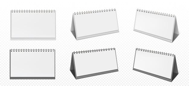 Kalendarz na biurko ze spiralą i pustymi stronami na przezroczystym tle. realistyczna makieta kalendarza z białego papieru, planowania biura lub notatnika stojącego na stole