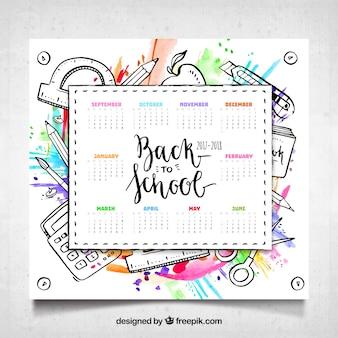 Kalendarz szkoły z materiałami i stylem akwarela