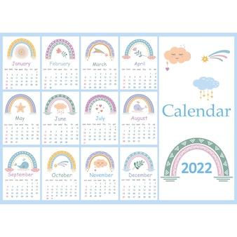Kalendarz w stylu boho na rok 2022 z abstrakcyjnymi tęczami. nadaje się do dekoracji pokoju dziecięcego lub sypialni.