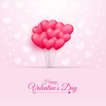 Kaligrafia szczęśliwy tekst walentynki i kilka balonów w kształcie różowego serca na różowym tle.
