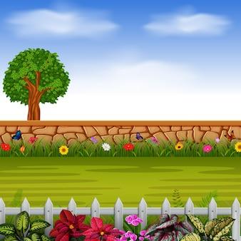 Kamień z wysokim drzewem i kwiatami