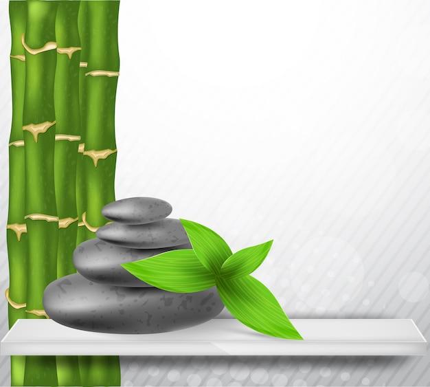 Kamień zen z zielonym bambusem i liśćmi