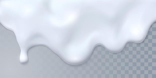 Kapie białe mleko na białym tle