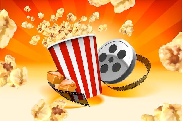 Karmelowy popcorn z elementami rolki filmu i odciski latające w powietrzu, paski pomarańczowe tło