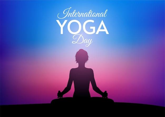 Karta międzynarodowego dnia jogi z kobietą na tle zachodu słońca