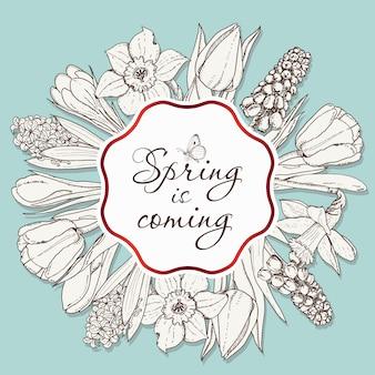 Karta na sezon wiosenny z białą ramą i kwiatami.