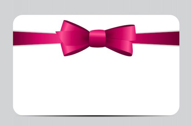 Karta podarunkowa z różową wstążką i kokardą.