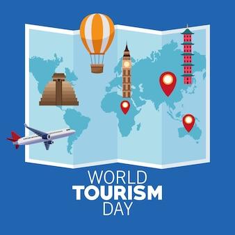 Karta światowego dnia turystyki z papierową mapą i projektowaniem ilustracji wektorowych zabytków