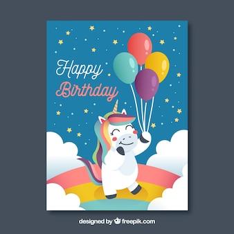 Karta urodzinowa z jednorożca trzyma niektóre balony