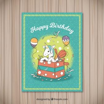 Karta urodzinowa z jednorożca w pudełku
