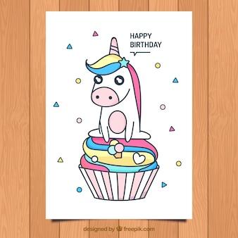 Karta urodzinowa ze ślicznym jednorożcem i pucharem