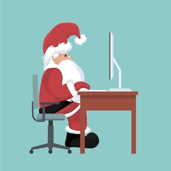 Kartka bożonarodzeniowa święty mikołaj na jego komputerze