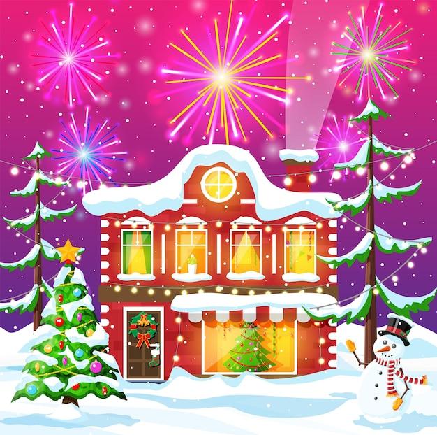 Kartka bożonarodzeniowa z miejskim krajobrazem i fajerwerkami. pejzaż z kolorowymi domami z salutem w nocy. zimowa wioska przytulne miasto panorama miasta. nowy rok boże narodzenie banner xmas. ilustracja wektorowa płaskie