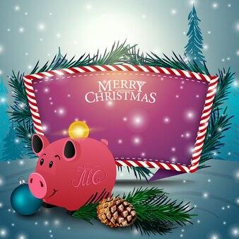 Kartka bożonarodzeniowa z purpurowym teksta szablonem i prosiątko bankiem