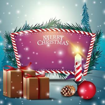 Kartka bożonarodzeniowa z purpurowym teksta szablonem, świeczką i prezentami ,.