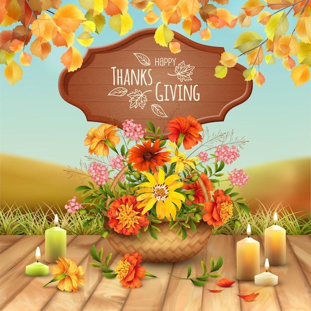 Kartka dziękczynienia z koszem wypełnionym jesiennymi kwiatami i zapaloną świecą