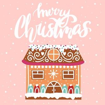 Kartka noworoczna świąteczny domek z piernika na różowym tle wesołych świąt