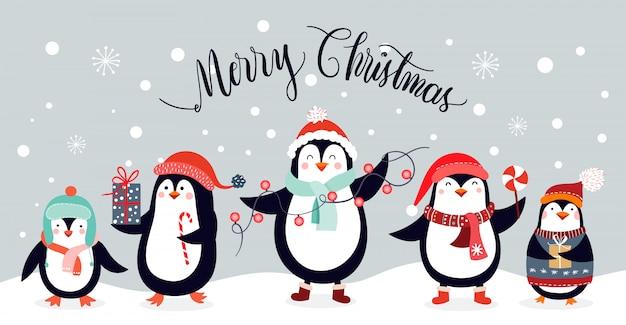 Kartka świąteczna z cute pingwiny na białym tle na tle zimy