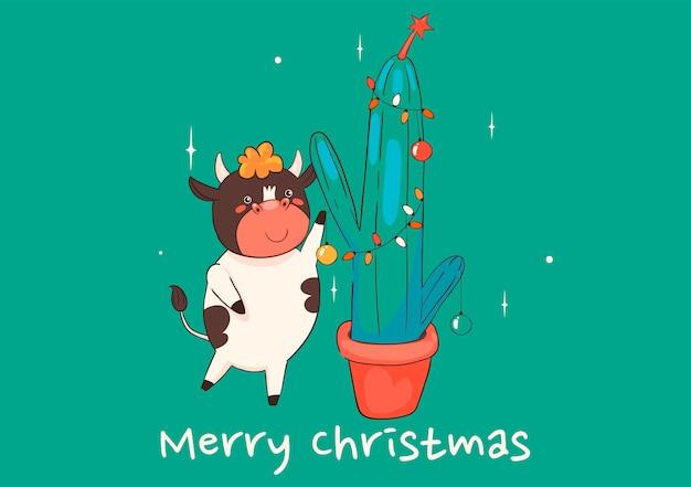 Kartka świąteczna z krową dekorującą kaktusa. grafika