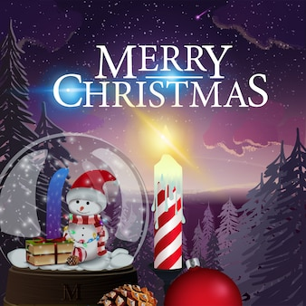 Kartka świąteczna z piękną zimową krajobraz, świeca i świecie śniegu