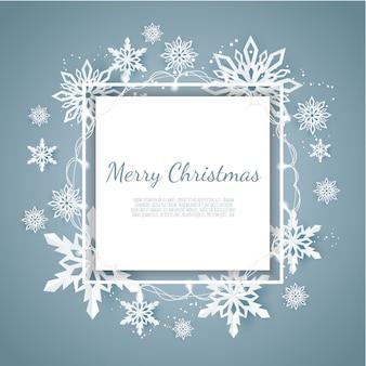 Kartka świąteczna z płatkami śniegu papieru, spadające płatki śniegu na ciemnoniebieskim tle zimy,