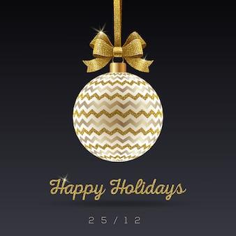 Kartka świąteczna z życzeniami - ozdobna bombka bożonarodzeniowa z kokardą z brokatu złota.
