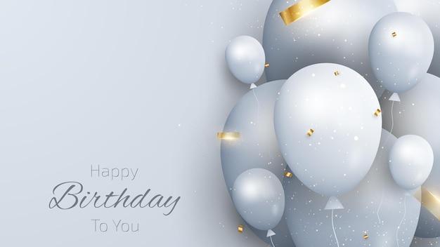 Kartka urodzinowa z balonami i złotą wstążką.